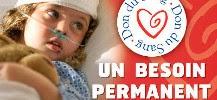 Photo d'un enfant malade en attente d'une transfusion sanguine